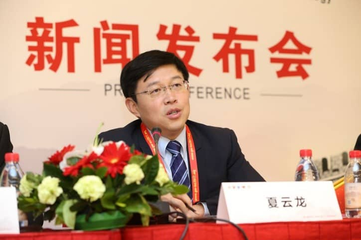 Professor Wang Hua speaking at the press conference